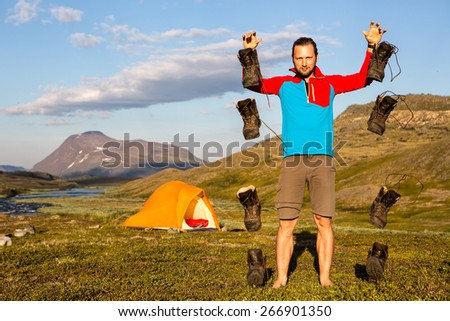 Hiking Boots are falling - stock photo