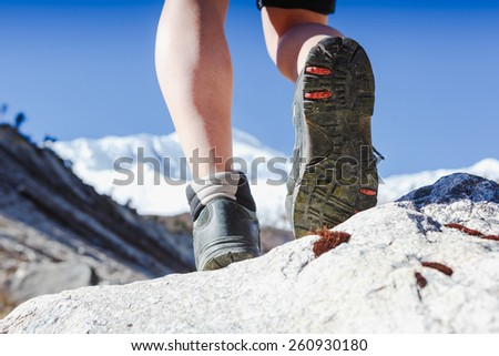 Hiking boots in outdoor action - stock photo