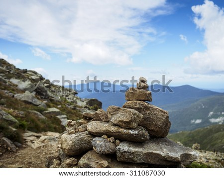 Hiking cairn marking trail to summit of Franconia ridge, White mountains, New Hampshire - stock photo
