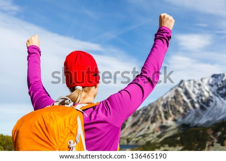 Hiking climbing woman and success in mountains, arms outstretched. Motivation and inspiration concept, Fitness and healthy lifestyle outdoors in wild nature - stock photo