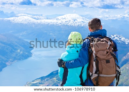 Hiking couple looking at view - stock photo
