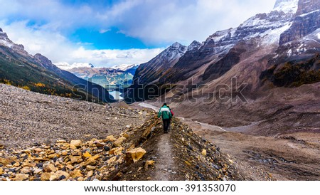 Hiking down to Lake Louise on the lateral moraine at the Plain of Six Glaciers at an elevation of 2150 meters or 7000 feet in Banff National Park in the Canadian Rocky Mountains - stock photo