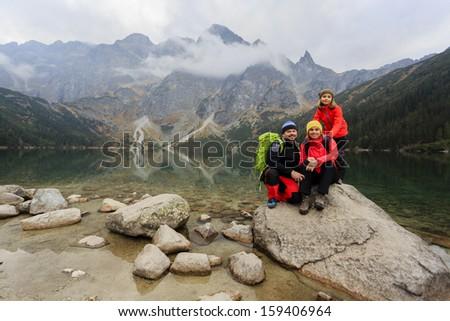 Hiking - family on mountain trek - stock photo