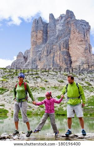 """Hiking, Family on mountain trek - Tre Cime di Lavaredo """" Drei Zinnen """" - Dolomites - Italy - stock photo"""