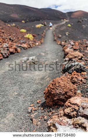 Hiking footpath in beautiful rocky volcanic mountains landscape, Canary Islands La Palma, Spain - stock photo