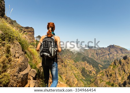 Hiking girl in beautiful mountains, Portugal, Madeira