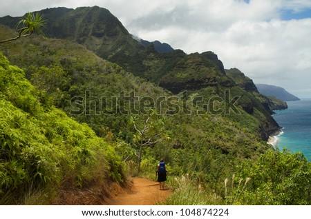 hiking girl Napali Coasr Kauai - stock photo