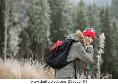 Hiking in autumn or winter mountains - stock photo