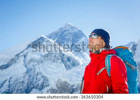 Hiking in Himalaya mountains. Face to face with mount Everest, Earth's highest mountain. Travel sport lifestyle concept - stock photo