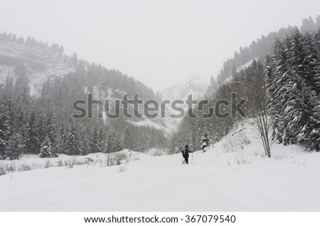 Hiking in the French Alps with snowshoes in cold winter weather