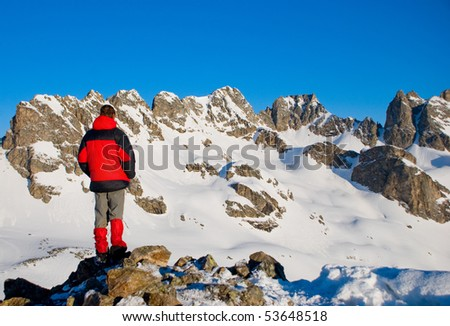 hiking in the snowy mountains - stock photo