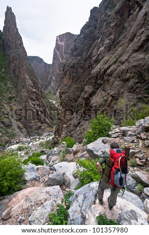 Hiking into the Black Canyon on the SOB trail - stock photo