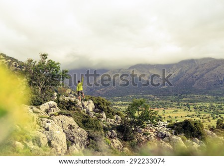 Hiking man looking at beautiful with arms up outstretched, mountains inspirational landscape. Hiker person reaching goal, successful on rocky trail footpath.Healthy fitness lifestyle outdoors concept. - stock photo