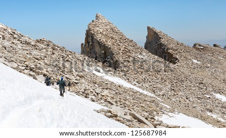 Hiking Mount Whitney. Hikers descending from California's highest mountain peak. - stock photo