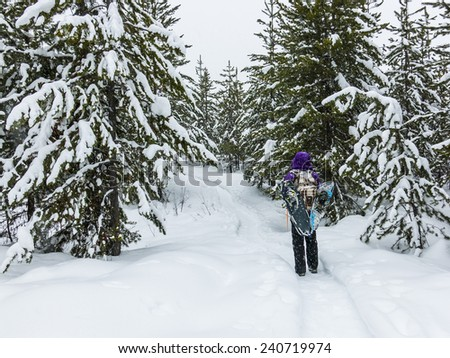 Hiking on Snowy Winter Trail - stock photo