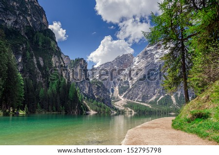 Hiking path along the pearl of the Dolomites, the Pragser wildsee or Lake Braies with Mount Seekofel in the background