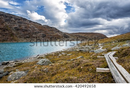 Hiking Path in northern Sweden - stock photo