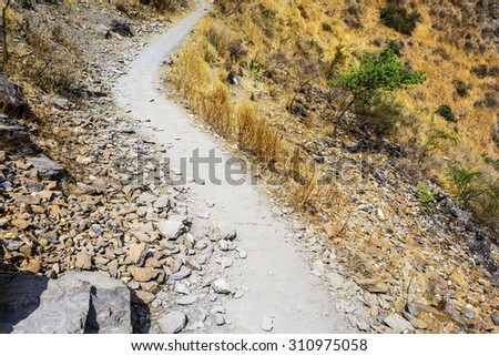 Hiking path (the high road) of Tiger Leaping Gorge. Located in Shangri-La County, 60 kilometres north of Lijiang City, Yunnan Province, China. - stock photo