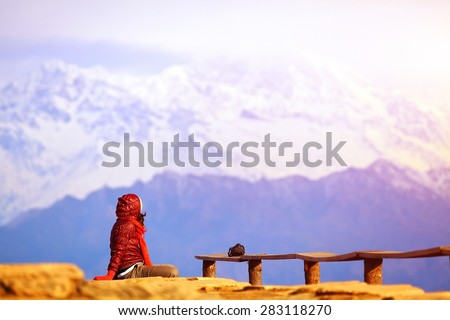Hiking photographer taking pictures. Himalaya, Nepal. Trek around Annapurna mount. Poon Hill. - stock photo