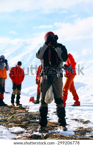 Hiking photographer taking pictures. Trek around Annapurna mount.  - stock photo