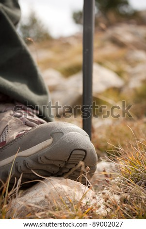 Hiking shoes close-up on top of a stone - stock photo