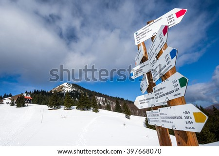 Hiking signpost in Velka Fatra mountains, winter  trip, Slovakia
