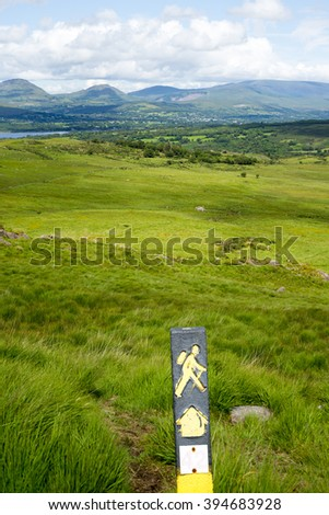hiking signpost with mountain view from the kerry way walk in ireland - stock photo