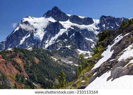 Hiking Snowfields Glaciers Artist Point Mount Shuksan Mount Baker Highway Snow Mountain Washington Pacific Northwest  - stock photo