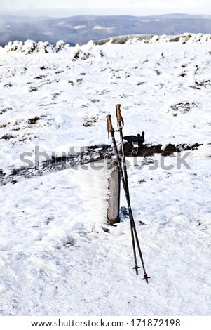 Hiking sticks in snow in mountains - stock photo