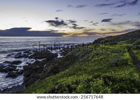 Hiking the Big Sur Coast Trail at Sunset on the California Central Coast, near Cambria, CA.  - stock photo