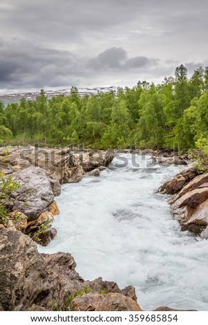Hiking the Norwegian mountains at Svartisen glacier - stock photo