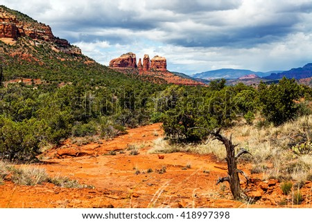 Hiking trail in scenic Sedona, Arizona with view of Cathedral Rock in the background - stock photo