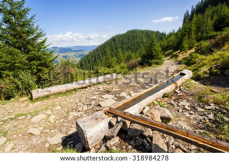 Hiking trail in the mountains of the Carpathians - stock photo