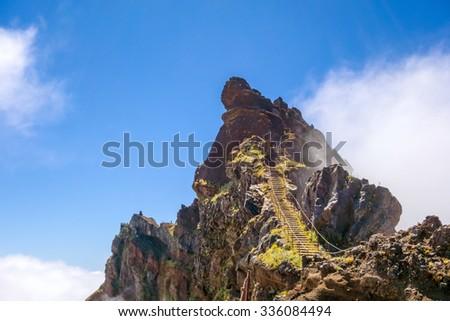 Hiking trail passage from mountain Pico Arieiro to Pico Ruivo, Madeira - stock photo