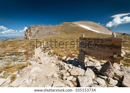 Hiking trail sign crosses the Great Divide high in the Colorado Rocky Mountains - stock photo