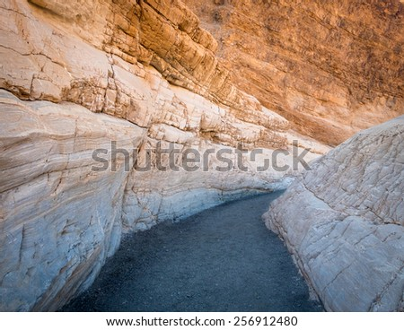 Hiking trail through the narrows at Mosaic Canyon in Death Valley National Park - stock photo