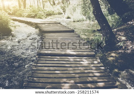 Hiking Trail with Sunlight with Vintage Instagram Film Effect - stock photo