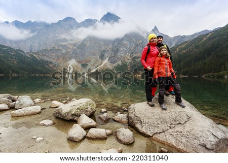 Hiking, trekking - family on mountain trek - stock photo