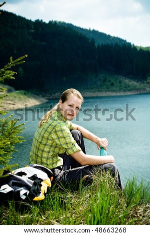 hiking woman in front of wild nature - stock photo