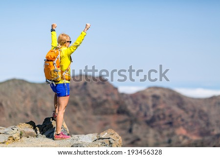 Hiking woman with backpack and success in mountains. Fitness and healthy lifestyle outdoors in summer nature on La Palma, Canary Islands - stock photo
