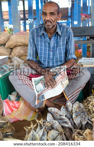 HIKKADUWA, SRI LANKA - MARCH 9, 2014: Local street vendor selling fish. The Sunday market is a fantastic way to see Hikkaduwa's local life come alive along with fresh produce and local delicacy. - stock photo