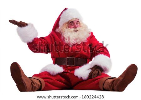 Hilarious and funny Santa Claus showing presenting gesture while sitting on a white background full length - stock photo