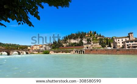 Hill and Ponte Pietra - Verona Italy / Ponte Pietra (Stone bridge) - 1st century B.C. and views of the hills north of Verona with the famous roman theater. Verona, Veneto, Italy - stock photo