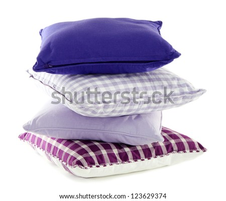 Hill colorful pillows isolated on white - stock photo