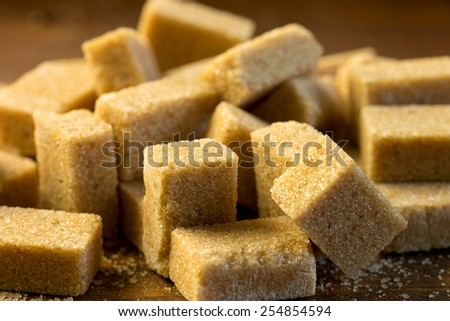 hill of brown sugar cubes - stock photo
