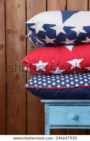 Hill of colorful pillows on rustic wooden background