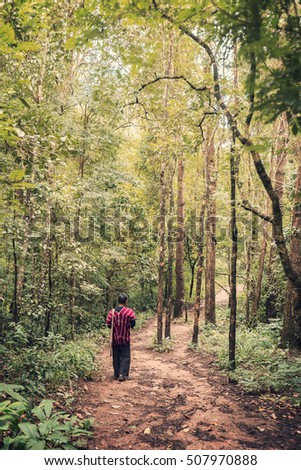 hill tribe man walking along a forest trail in northern Thailand, vintage look