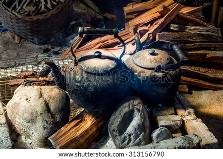 Hill tribe old style native kitchen at Laos village,Boil water with firewood. - stock photo