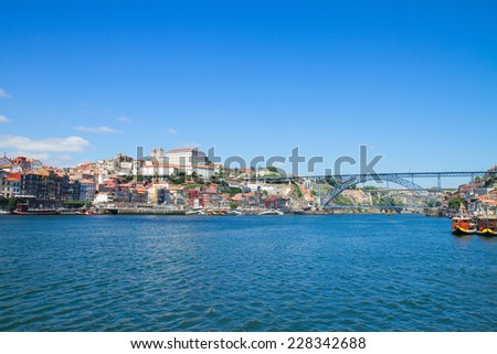 hill with old town of Porto and Dom Luis I bridge at sunny day, Portugal - stock photo