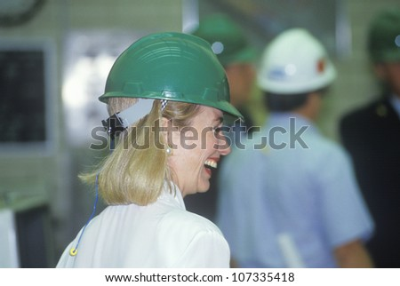 Hillary Rodham Clinton meets with workers at an electric station on the 1992 Buscapade campaign tour in Waco, Texas - stock photo
